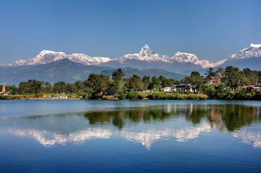 View At Annapurna Mountain Range And Its Reflection In Phewa Lak